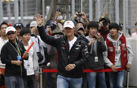 Mercedes Formula One driver Michael Schumacher of Germany waves to fans before an autograph signing session at the Korea International Circu