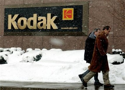 Kodak workers enter corporate headquarters in Rochester, New York January 22, 2004.