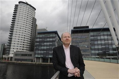 Mark Thompson poses for media on a visit to Media City the company's new northern headquarters in Salford, northern England in this May 10,