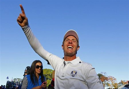 Team Europe golfer Nicolas Colsaerts of Belgium celebrates winning the Ryder Cup for Europe during the 39th Ryder Cup singles golf matches a