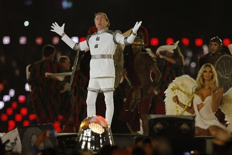 British actor Eric Idle performs during the closing ceremony of the London 2012 Olympic Games at the Olympic Stadium, August 12, 2012. REUTE