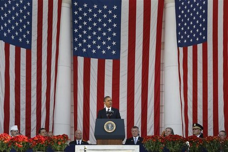 U.S. President Barack Obama stands for Veterans Day remarks at Arlington National Cemetery in Arlington, Virginia, November 11, 2012. REUTER