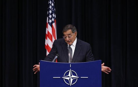 U.S. Secretary of Defense Leon Panetta reacts as he answers questions during a NATO defence ministers meeting at the Alliance headquarters i