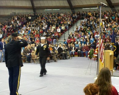 The US flag is honored during the Nov. 12, 2012 Veterans' Day program at Holland High.