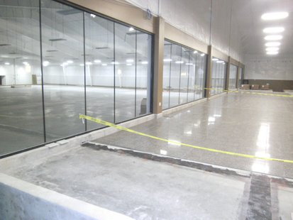 Wausau Curling Club's main entrance area, where floor tile has been installed.  The ice rink is through the windows on the left.