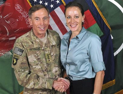 Commander of the International Security Assistance Force/U.S. Forces in Afghanistan General David Petraeus shakes hands with author Paula Br