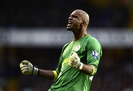 Wigan Athletic's goalkeeper Ali Al Habsi celebrates after team mate Ben Watson scored against Tottenham Hotspur during their English Premier