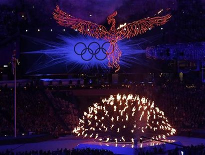 A flaming phoenix flies above the Olympic flame during the closing ceremony of the London 2012 Olympic Games at the Olympic Stadium August 1
