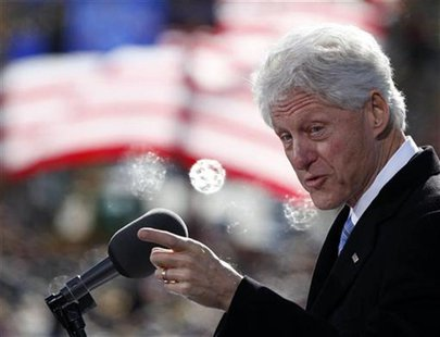 Former U.S. President Bill Clinton speaks to a crowd at a campaign event for U.S. President Barack Obama at State Capitol Square in Concord,