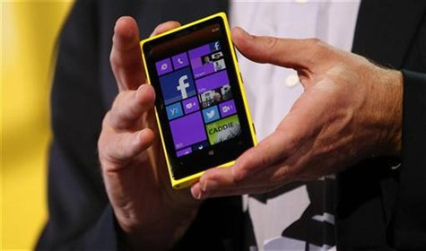 Microsoft CEO Steve Ballmer displays a Nokia Lumia 920 featuring Windows Phone 8 during an event in San Francisco, California October 29, 20