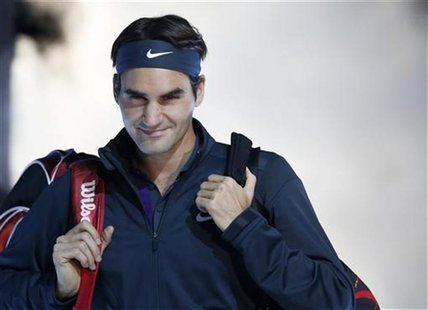 Switzerland's Roger Federer arrives for his final tennis match at the ATP World Tour Finals against Serbia's Novak Djokovic at the O2 Arena