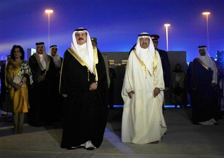 Bahrain's King Hamad bin Isa al-Khalifa (L) and Prime Minister Prince Khalifa bin Salman al-Khalifa arrive at the inauguration ceremony of t