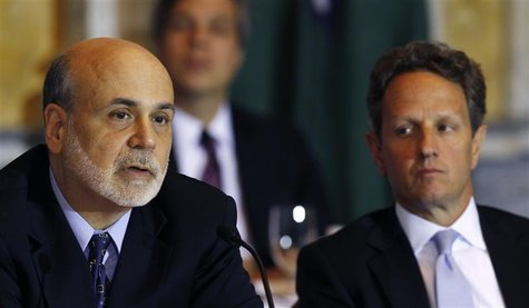 U.S. Secretary of the Treasury Timothy Geithner (R) listens to Federal Reserve Chairman Ben Bernanke (L) at the Treasury Department for the