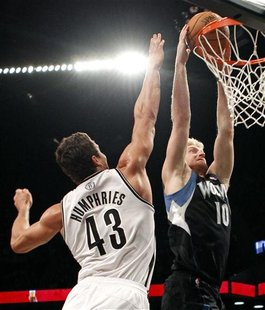 Minnesota Timberwolves forward Chase Budinger dunks the ball in front of Brooklyn Nets forward Kris Humphries in the first quarter of their