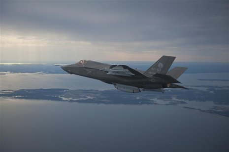 The U.S. Marine Corps version of Lockheed Martin's F35 Joint Strike Fighter, F-35B test aircraft BF-2 flies with external weapons for the fi