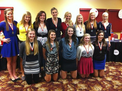 The 2012 Coldwater varsity volleyball team poses at the team banquet.