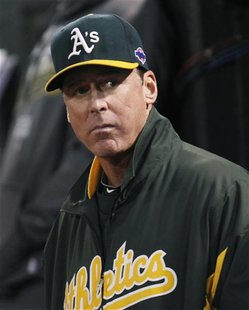 Oakland Athletics manager Bob Melvin watches from the dugout as his team plays the Detroit Tigers in Game 4 of their MLB ALDS playoff baseba