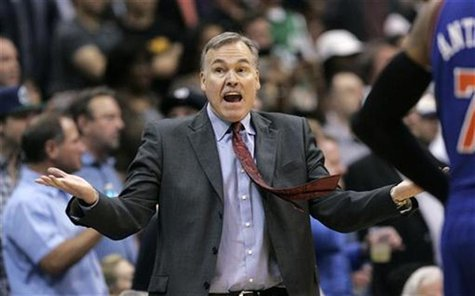 New York Knicks head coach Mike D'Antoni gestures during the second half of their NBA basketball game against the Dallas Mavericks in Dallas