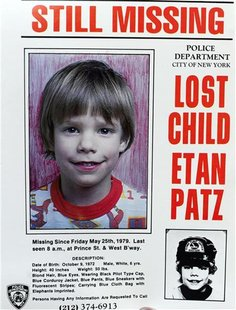 A copy photo of the original missing poster of Etan Patz is shown during a news conference near a New York City apartment building, where po