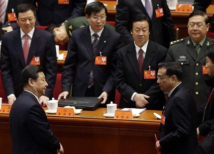 China's Vice President Xi Jinping (front L) and China's Vice-Premier Li Keqiang (front R) leave their seats after the closing session of 18t