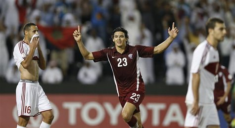 Qatar's Sebastian Soria celebrates after scoring a goal against Lebanon during their 2014 World Cup qualifying soccer match in in Doha, Nove
