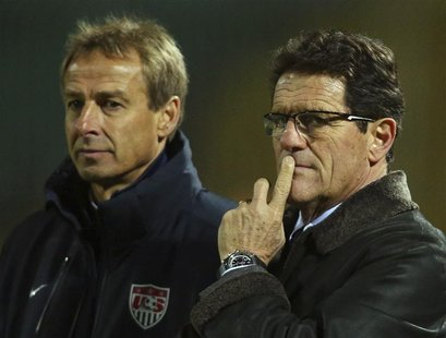 Russia coach Fabio Capello (R) and U.S. coach Jurgen Klinsmann watch their teams during their international friendly soccer match in Krasnod