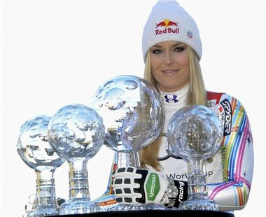Lindsey Vonn from the U.S. poses with her trophies after winning the women's overall, downhill, super G and combined World Cup at the Alpine