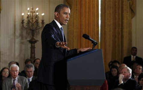 U.S. President Barack Obama gestures while addressing his first news conference since his reelection, at the White House in Washington Novem
