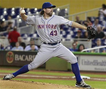 New York Mets starting pitcher R.A. Dickey delivers against the Miami Marlins during the first inning of their MLB National League baseball