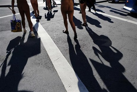 Nudists march to city hall during a rally against banning nudity in parts of the city in San Francisco, California, November 14, 2012. REUTE