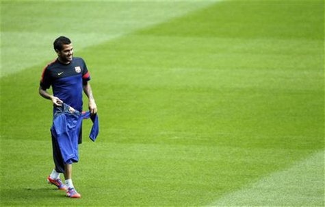 Barcelona's Dani Alves attends a training session at Camp Nou stadium on the eve of their Champions League soccer match against Celtic in Ba