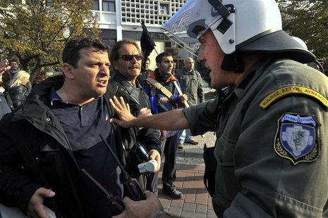 A protester argues with a policeman during an anti-austerity rally in Thessaloniki, northern Greece November 15, 2012. REUTERS/Alexandros Av