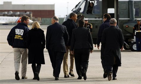 U.S. President Barack Obama (C) walks to Marine One upon his arrival in New York City to view recovery efforts from Hurricane Sandy, Novembe