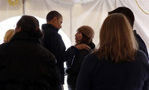 U.S. President Barack Obama greets residents affected by Hurricane Sandy at a Staten Island FEMA disaster recovery center in New York, Novem
