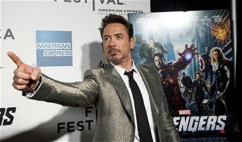 "Robert Downey Jr. poses as he arrives at the screening of the film ""Marvel's The Avengers"" for the closing night of the 2012 Tribeca Film Fe"