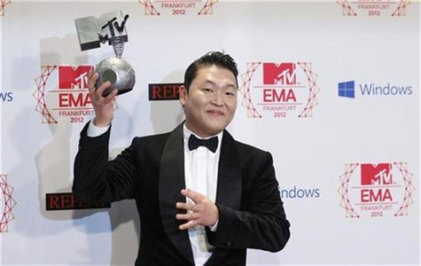 South Korean singer PSY poses with his Best Video award backstage during the MTV European Music Awards 2012 show at the Festhalle in Frankfu