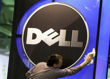 A man wipes the logo of the Dell IT firm at the CeBIT exhibition centre in Hannover in this February 28, 2010 file photo. REUTERS/Thomas Pet