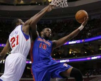 Detroit Pistons center Greg Monroe (10) shoots under pressure from Philadelphia 76ers forward Thaddeus Young (21) during 2011 game action. REUTERS/Tim Shaffer