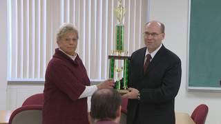 Pittsfield town clerk Jan Bodart and town chairman Keith Deneys with the Voter Challenge trophy, Thursday, November 15, 2012. (courtesy of FOX 11).