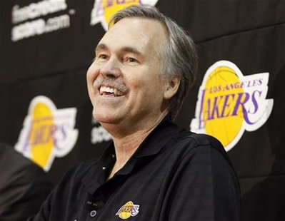 New Los Angeles Lakers head coach Mike D'Antoni smiles during a media conference after practice at the Lakers' training facility in El Segun