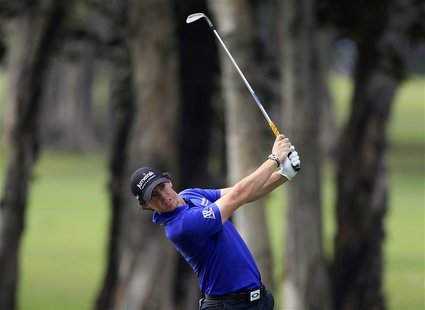 Rory McIlroy from Northern Ireland hits a shot on the sixth fairway during the second day of the Hong Kong Open Championship November 16, 20