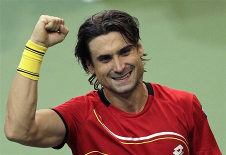 Spain's David Ferrer celebrates after winning over Czech Republic's Radek Stepanek during their Davis Cup tennis tournament final match in P