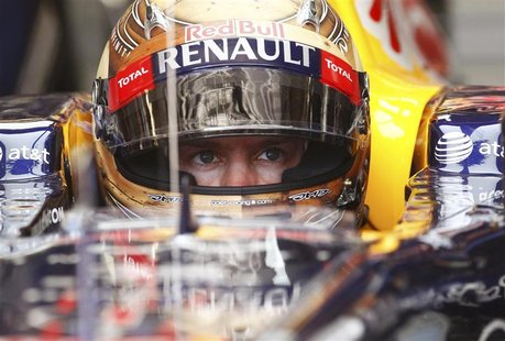 Red Bull Formula One driver Sebastian Vettel of Germany sits in his car during the second practice session of the U.S. F1 Grand Prix at the