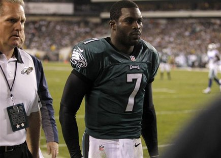 Philadelphia Eagles quarterback Michael Vick leaves the field with a concussion while playing against the Dallas Cowboys during the second q