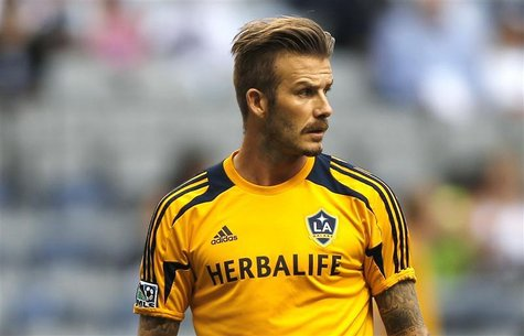 David Beckham of the L.A. Galaxy warms up before his team faces the Vancouver Whitecaps during their MLS soccer match in Vancouver, British