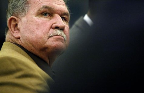 Former National Football League player and coach Mike Ditka listens during a hearing on Capitol Hill in Washington September 18, 2007. REUTE
