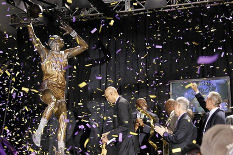 (L - R)Former Los Angeles Lakers basketball player and NBA Hall of Famer Kareem Abdul-Jabbar looks at a bronze statue of himself as it is un
