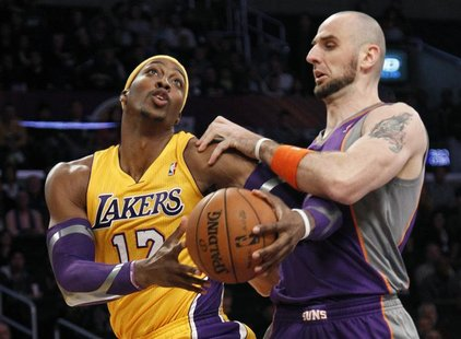 Phoenix Suns' Marcin Gortat (R) of Poland defends against Los Angeles Lakers' Dwight Howard during the first half of their NBA basketball ga