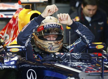 Red Bull Formula One driver Sebastian Vettel of Germany sits in his car during the third practice session of the U.S. F1 Grand Prix at the C