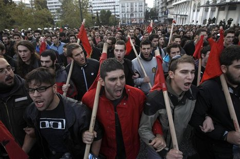 Greek students shout slogans during a rally marking the 39th anniversary of a 1973 student uprising against a U.S. backed dictatorship rulin